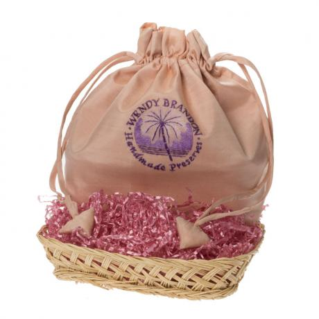 Peach silk drawstring bag with wicker basket